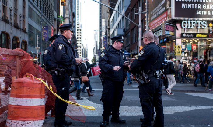 NEW YORK, NY - NOVEMBER 14: Police officers keep watch in Times Square following a series of terrorist attacks in Paris on November 14, 2015 in New York City. Security in New York City has increased following the coordinated assault on Paris which ISIS claimed responsibility for. At least 120 people have been killed and over 200 injured, 80 of which seriously.  (Photo by Andrew Renneisen/Getty Images)