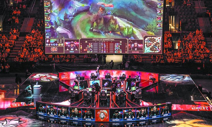 The teams Misfits Gaming and G2 Esports compete in the finals of the European League of Legends Championship Series at the AccorHotels Arena in Paris on Sept. 3. (CHRISTOPHE SIMON/AFP/GETTY IMAGES)