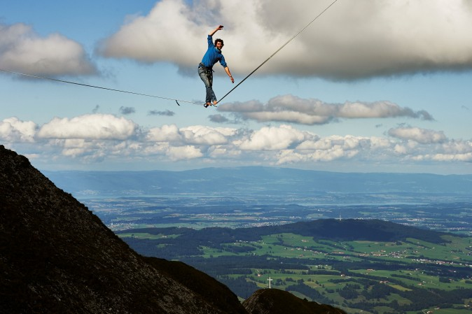 Daniel Laruelle of South Africa walks on a line during the Highline Extreme event in Moleson peak, Switzerland ,on Sept. 15, 2017.  Fifty of the Worlds best slackliners compete till the 17th on six different lines ranging from 45 metres to 304 metres.  (MICHAEL BUHOLZER/AFP/Getty Images)