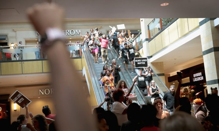 Demonstrators march through the West County Mall protesting the acquittal of former St. Louis police officer Jason Stockley on September 16, 2017 in St. Louis, Missouri. The St. Louis area is bracing for a second day of protests following yesterday's acquittal of Stockley, who was charged with first-degree murder last year following the 2011 shooting of Anthony Lamar Smith.   U2 cancelled its show scheduled Saturday night due to the protests. (Scott Olson/Getty Images)