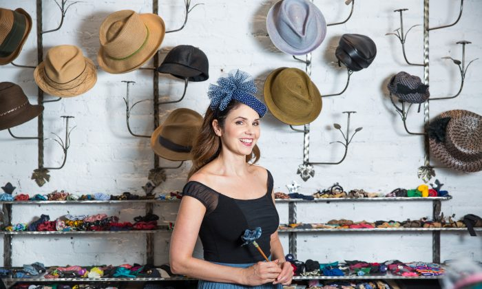 Jennifer Ouellette with a collection of her handmade hats at her Jennifer Ouellette studio in New York on Sept. 15, 2017. (Benjamin Chasteen/The Epoch Times)