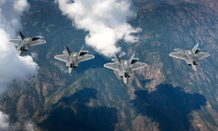 A four-ship formation of F-22 Raptors from the 94th Fighter Squadron and 1st Fighter Wing fly in formation over the Rocky Mountains in Colorado. (U.S. Air Force photo/Staff Sgt. Carlin Leslie)