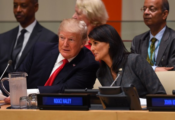 US President Donald Trump and US ambassador to the United Nations Nikki Haley speak during a meeting on United Nations Reform at the United Nations headquarters in New York on Sept. 18, 2017. (TIMOTHY A. CLARY/AFP/Getty Images)