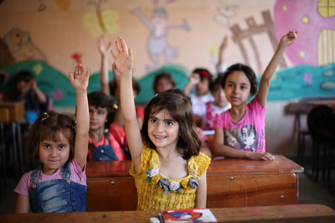 Syrian students in a school  in the rebel-held Eastern Ghouta town of Douma on Sept. 18, 2017 Syria's six-year conflict has ravaged its infrastructure and caused losses to its economy of $226 billion, according to estimates published by the World Bank. (AMER ALMOHIBANY/AFP/Getty Images)