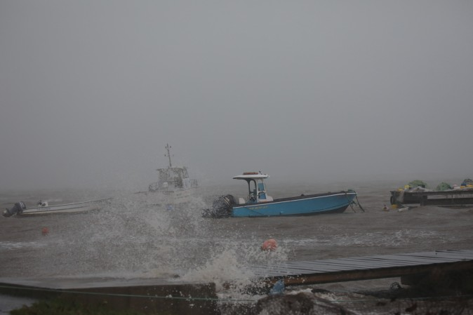 Boats remain anchored in a wharf as Hurricane Maria approaches in Guadeloupe island, France, on Sept. 18, 2017. (REUTERS/Andres Martinez Casares)