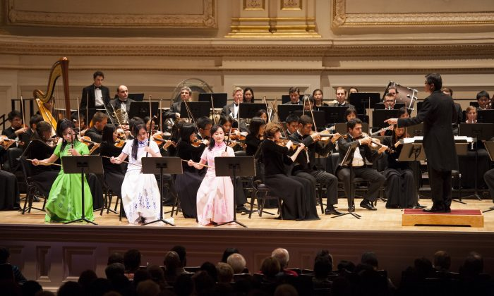Three erhus players perform with Shen Yun Symphony Orchestra at Carnegie Hall on Oct. 18, 2015. (Courtesy of Shen Yun Performing Arts)