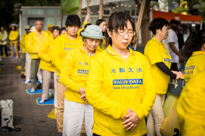 Falun Gong exercise at the Dag Hammarskjold Plaza near the United Nations headquarters in New York on Sept. 19, 2017, to raise awareness about the persecution inside China that is now in its 18th year. (Benjamin Chasteen/The Epoch Times)