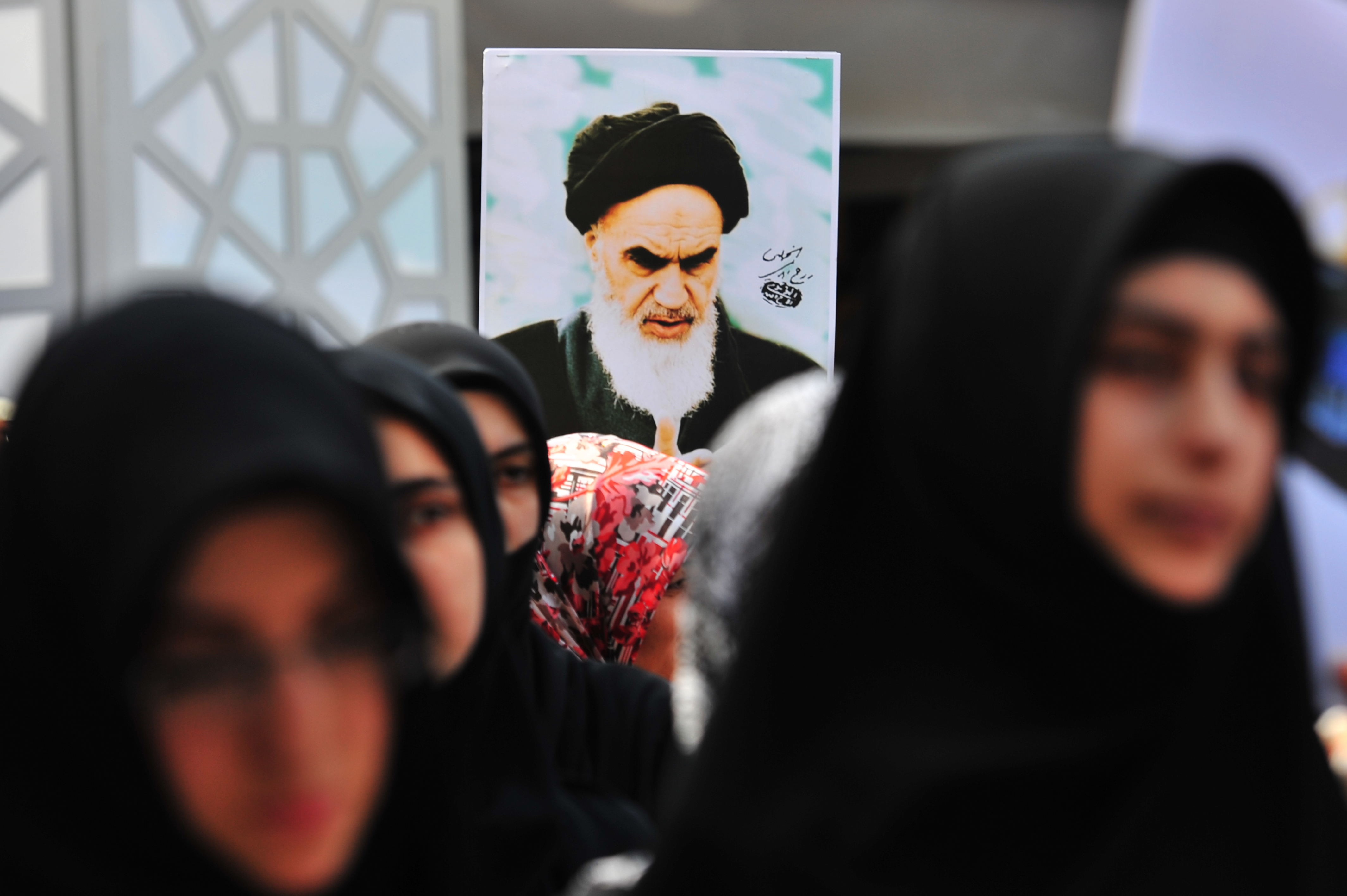 A Turkish Muslim woman holds a picture of Iran's late leader Ayatollah Khomeini during a protest in front of Beyazit Mosque after a Friday pray in Istanbul on Aug. 26, 2011. (MUSTAFA OZER/AFP/Getty Images)