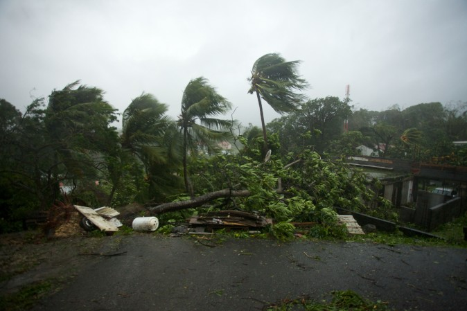 """A picture taken on Sept. 19, 2017 shows the powerful winds and rains of hurricane Maria battering the city of Petit-Bourg on the French overseas Caribbean island of Guadeloupe. Hurricane Maria strengthened into a """"potentially catastrophic"""" Category Five storm as it barrelled into eastern Caribbean islands still reeling from Irma, forcing residents to evacuate in powerful winds and lashing rain. (CEDRIK-ISHAM CALVADOS/AFP/Getty Images)"""