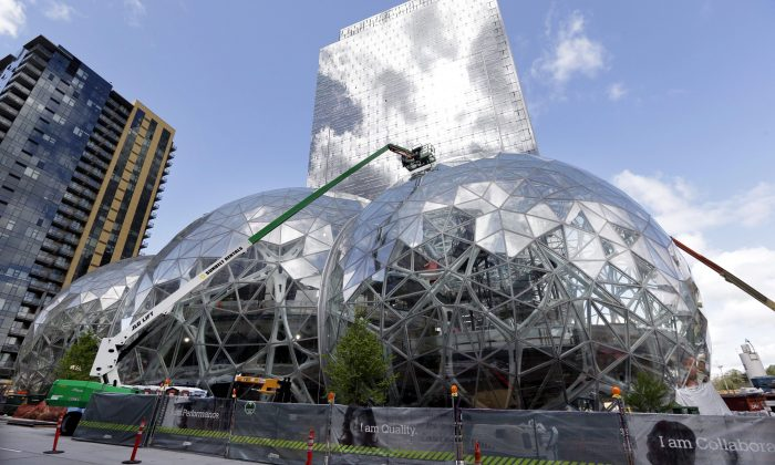 Construction continues on three large glass-covered domes as part of an expansion of the Amazon.com campus in downtown Seattle, April 27, 2017. Amazon plans to spend more than $5 billion to build another headquarters in North America to house as many as 50,000 employees. (AP Photo/Elaine Thompson)
