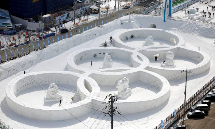 An ice sculpture of the Olympic rings is seen during the Pyeongchang Winter Festival, near the venue for the opening and closing ceremony of the PyeongChang 2018 Winter Olympic Games in Pyeongchang, South Korea, Feb. 10, 2017.  (Reuters/Kim Hong-Ji/File Photo)