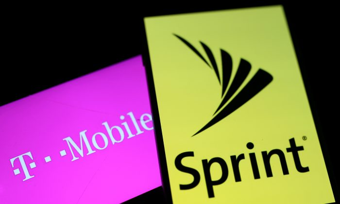 Smartphones with the logos of T Mobile and Sprint are seen in this illustration taken on Sept. 19 2017