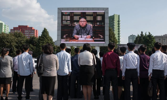 North Koreans listen to a television broadcast of a statement by communist dictator Kim Jong-Un, in Pyongyang, North Korea, on Sept. 22, 2017. (ED JONES/AFP/Getty Images)