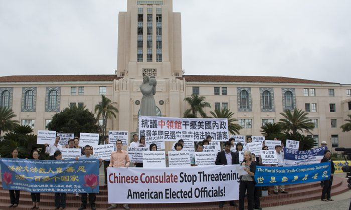 Practitioners of the spiritual group Falun Gong hold a rally at the San Diego County Administration Center on Sept. 13, calling on the Chinese Consulate to stop interfering with U.S. officials. (Mark Cao/The Epoch Times)