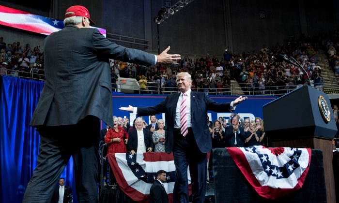 Republican Senator Luther Strange (L) walks to embrace President Donald Trump during a rally in Huntsville, Alabama, on Sept. 22, 2017. (BRENDAN SMIALOWSKI/AFP/Getty Images)