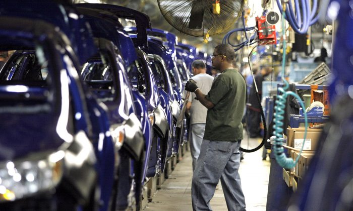 Assembly line at the Ford Motor's Assembly Plant, Dec. 14, 2011, in Wayne, Michigan. A new industry report says that U.S. manufacturers remain the prime targets for cyberattack and cyberespionage by malicious hackers. (Bill Pugliano/Getty Images)
