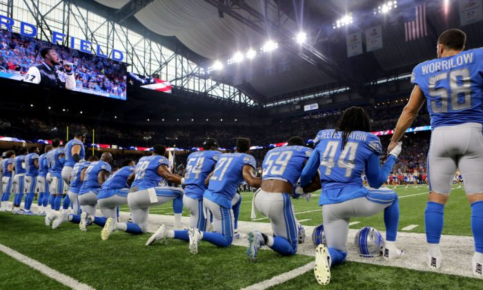 Members of the Detroit Lions take a knee during the playing of the national anthem prior to the start of the game against the Atlanta Falcons at Ford Field in Detroit on Sept. 24, 2017. (Rey Del Rio/Getty Images)