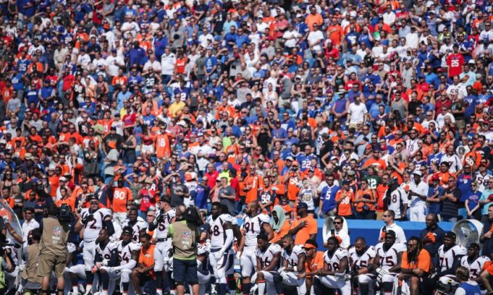 Denver Broncos players kneel during the American national anthem before an NFL game against the Buffalo Bills on Sept. 24, 2017, at New Era Field in Orchard Park, N.Y..  (Brett Carlsen/Getty Images)