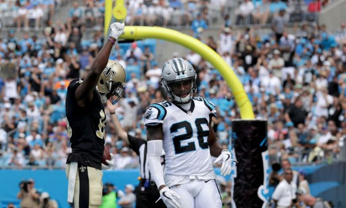 Brandon Coleman No. 16 of the New Orleans Saints reacts after scoring a touchdown as Daryl Worley No. 26 of the Carolina Panthers watches during their game at Bank of America Stadium on Sept. 24, 2017, in Charlotte, N.C.  (Streeter Lecka/Getty Images)