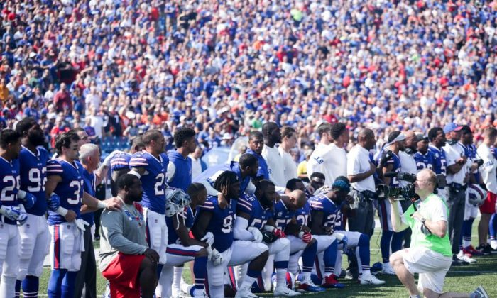 Buffalo Bills players kneel during the American National anthem before an NFL game against the Denver Broncos on September 24, 2017 at New Era Field in Orchard Park, New York.  (Brett Carlsen/Getty Images)