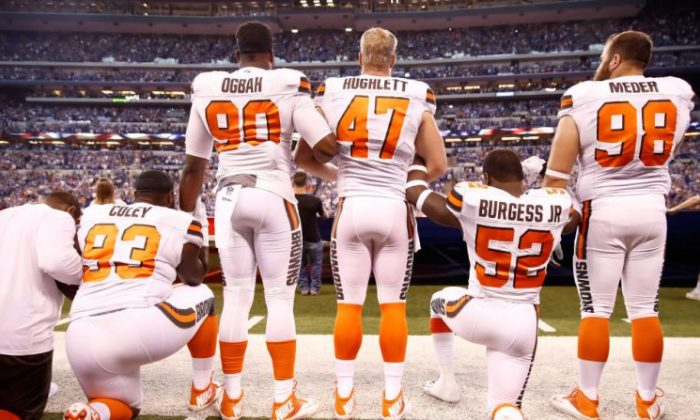 Members of the Cleveland Browns stand and kneel during the national anthem before the game against the Indianapolis Colts at Lucas Oil Stadium on Sept. 24, 2017, in Indianapolis, Ind. (Andy Lyons/Getty Images)
