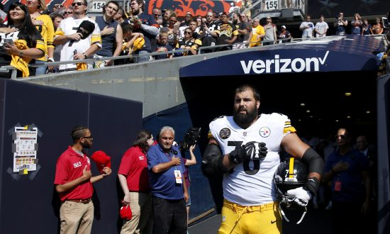 e7f609656 Alejandro Villanueva of the Pittsburgh Steelers stands by himself in the  tunnel for the national anthem