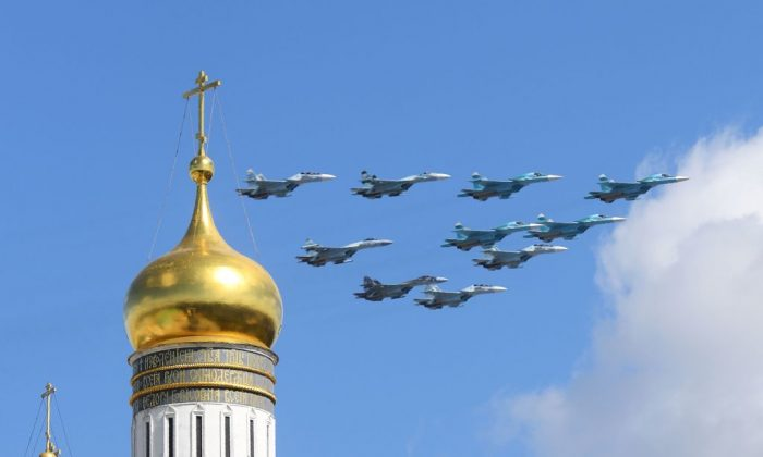 Russian Sukhoi Su-35 and Su-34 military aircrafts fly above the Ivan the Great Bell Tower before a Victory Day military parade in central Moscow on May 4, 2017. Russian military sources have told state-run news agency TASS that SU-35s will be among the aircraft performing bombing maneuvers during drills near Russia's North Korean border. (NATALIA KOLESNIKOVA/AFP/Getty Images)