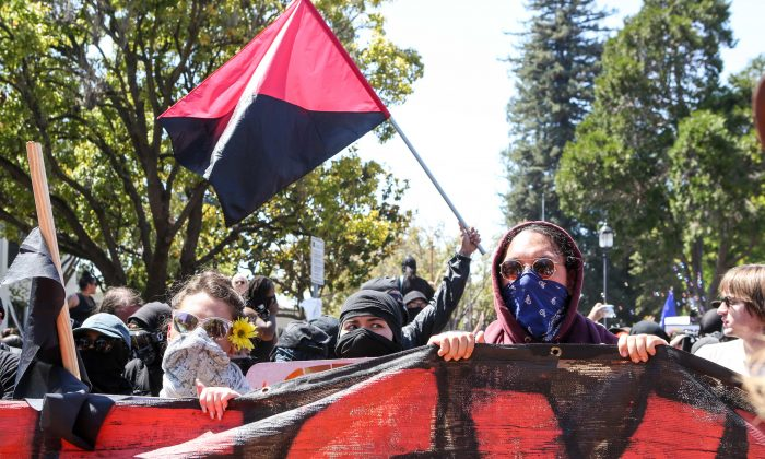Antifa members and counter protesters gather during a rightwing No-To-Marxism rally on August 27, 2017 at Martin Luther King Jr. Park in Berkeley, California. (AMY OSBORNE/AFP/Getty Images)