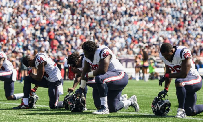 Members of the Houston Texans kneel before a game against the New England Patriots at Gillette Stadium on September 24, 2017 in Foxboro, Massachusetts. (Billie Weiss/Getty Images)