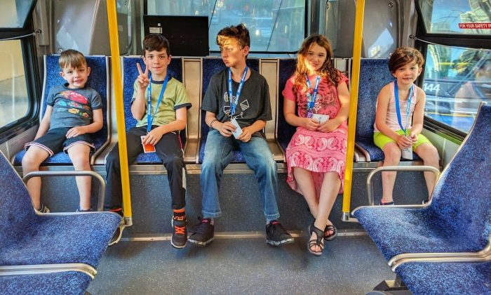 Adrian Crook's children ride a bus in Vancouver. (Courtesy of Adrian Crook)