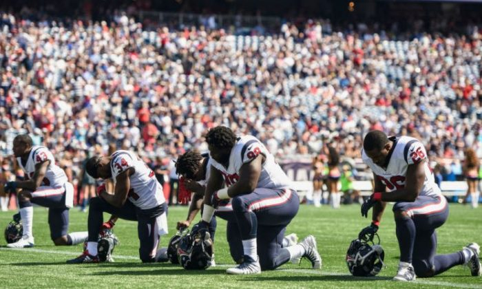 Members of the Houston Texans kneel before a game against the New England Patriots at Gillette Stadium in Foxboro, Mass., on Sept. 24, 2017. (Billie Weiss/Getty Images)