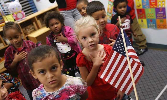Children recite the Pledge of Allegiance at the beginning of the school day at the federally funded Head Start school in Woodbourne, N.Y.  (John Moore/Getty Images)