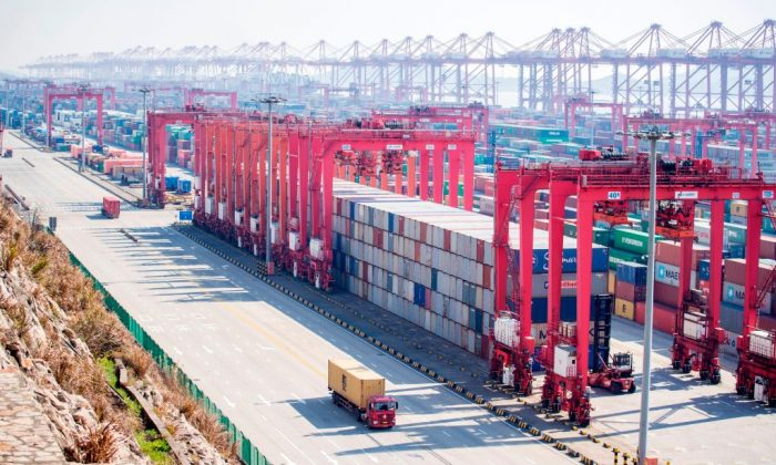 Containers organized in stacks at Yangshan Deep Water Port, part of the Shanghai Pilot Free Trade Zone in Shanghai on Feb. 13, 2017.  (JOHANNES EISELE/AFP/Getty Images)