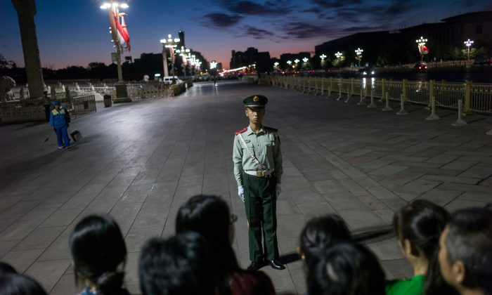 A paramilitary guard stands in front of a crowd at Tiananmen Square in Beijing on September 20, 2017. (Fred Dufour/AFP/Getty Images)