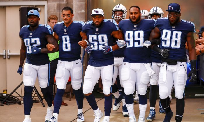 Tennessee Titans players walk onto the field before taking on the Seattle Seahawks at Nissan Stadium on Sept. 24, 2017, in Nashville, Tenn. (Far L) Delanie Walker No. 82.