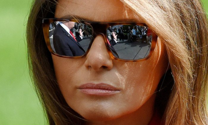 First lady Melania Trump looks on as US President Donald Trump talks to members of the media. (Olivier Douliery-Pool/Getty Images)
