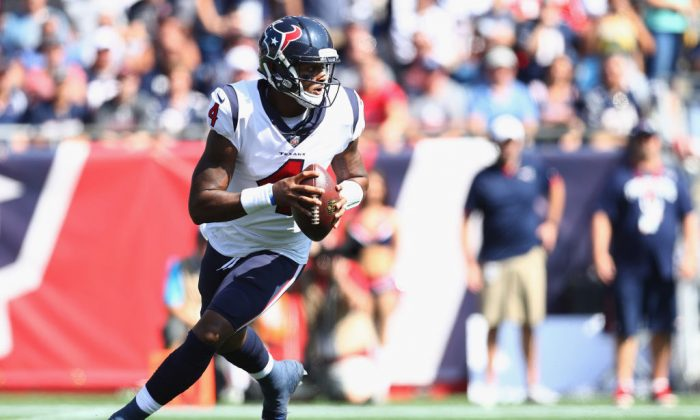 Deshaun Watson of the Houston Texans looks to throw during the first quarter of a game against the New England Patriots at Gillette Stadium n Foxboro, Mass., on Sept. 24, 2017. (Maddie Meyer/Getty Images)