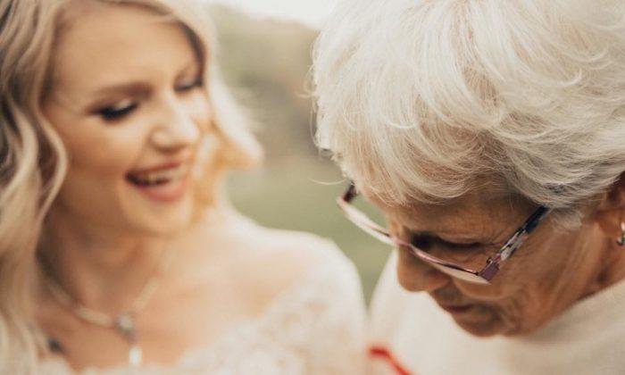 Jordyn Cleverly shares a moment with her grandmother Penny Jenson after revealing her wedding dress. (Kortney Peterson/KORTNEY J PHOTOGRAPHY)