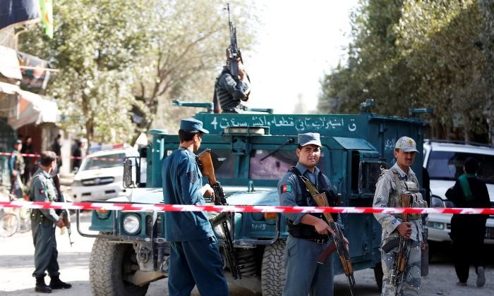 File Photo - Afghan security forces inspect at the site of a suicide attack near a large Shi'ite mosque, Kabul, Afghanistan. September 29, 2017. (Reuters/Omar Sobhani)