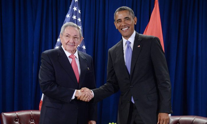 Then President Barack Obama (R) shakes hands with Cuban communist leader Raul Castro at the UN headquarters in New York on Sept. 29, 2015. (Anthony Behar-Pool/Getty Images)