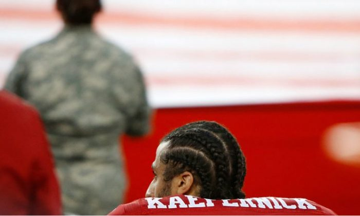 Colin Kaepernick No. 7 of the San Francisco 49ers kneels in protest during the national anthem prior to playing the Los Angeles Rams in their NFL game at Levi's Stadium on Sept. 12, 2016, in Santa Clara, Calif.  (Robert Reiners/Getty Images)