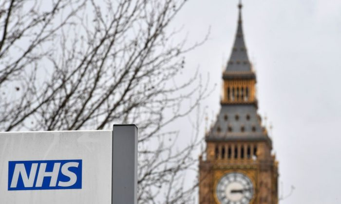 A NHS (National Health Service) sign is pictured outside St Thomas's Hospital, near the Houses of Parliament, in central London on March 8, 2017. (Ben Stansall/AFP/Getty Images)