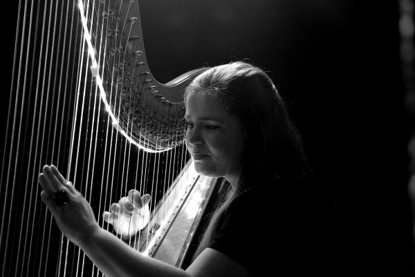 A file photo of a woman playing a harp.