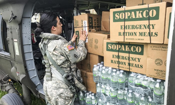 A Puerto Rico National Guard soldier helps transport food and water to Jayuya, Puerto Rico, on Sept. 27, 2017, while supporting Hurricane Maria relief efforts. (Army National Guard photo by Sgt. José Ahiram Díaz-Ramos)
