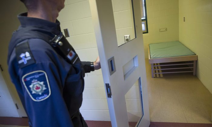 A corrections officer opens the door to a cell in the segregation unit at the Fraser Valley Institution for Women in Abbotsford, B.C., during a media tour on Oct. 26, 2017. (The Canadian Press/Darryl Dyck)