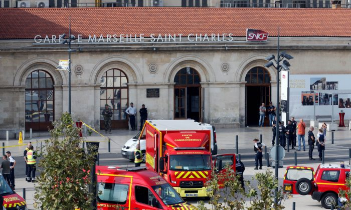 Emergency services vehicles are seen outside the Saint-Charles train station after French soldiers shot and killed a man who stabbed two women to death at the main train station in Marseille, France on Oct. 1, 2017.  (REUTERS/Jean-Paul Pelissier)