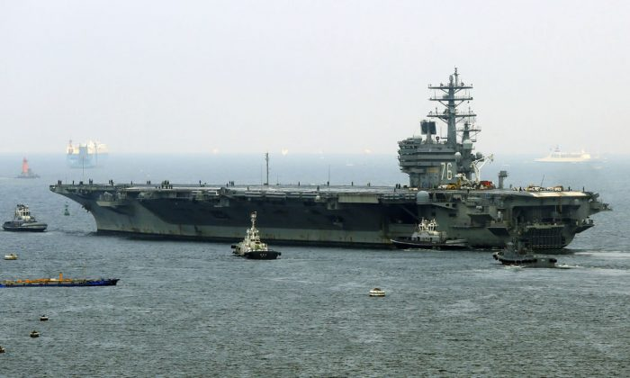 Nuclear-powered aircraft carrier USS Ronald Reagan departs the Yokosuka naval base in Yokosuka, Kanagawa prefecture on Sept. 8, 2017. (STR/AFP/Getty Images)