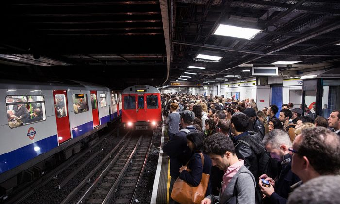 Commuters prepare to travel on the District Line of the London Underground, which is running a limited service due to a Tube strike on April 30, 2014. (Oli Scarff/Getty Images)