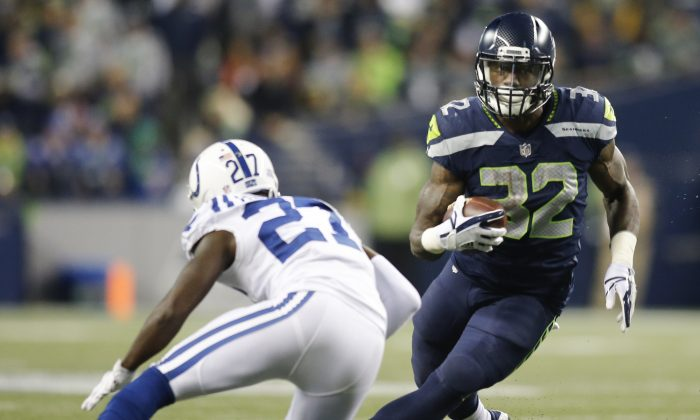Running back Chris Carson No. 32 of the Seattle Seahawks rushes against Nate Hairston No. 27 of the Indianapolis Colts in the third quarter of the game at CenturyLink Field on Oct. 1, 2017, in Seattle, Wash. (Jonathan Ferrey/Getty Images)