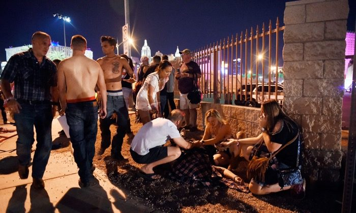People tend to the wounded outside the Route 91 Harvest Country music festival grounds after a shooting in Las Vegas on Oct. 1, 2017. (David Becker/Getty Images)